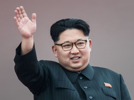 A popular dictator, waving at you