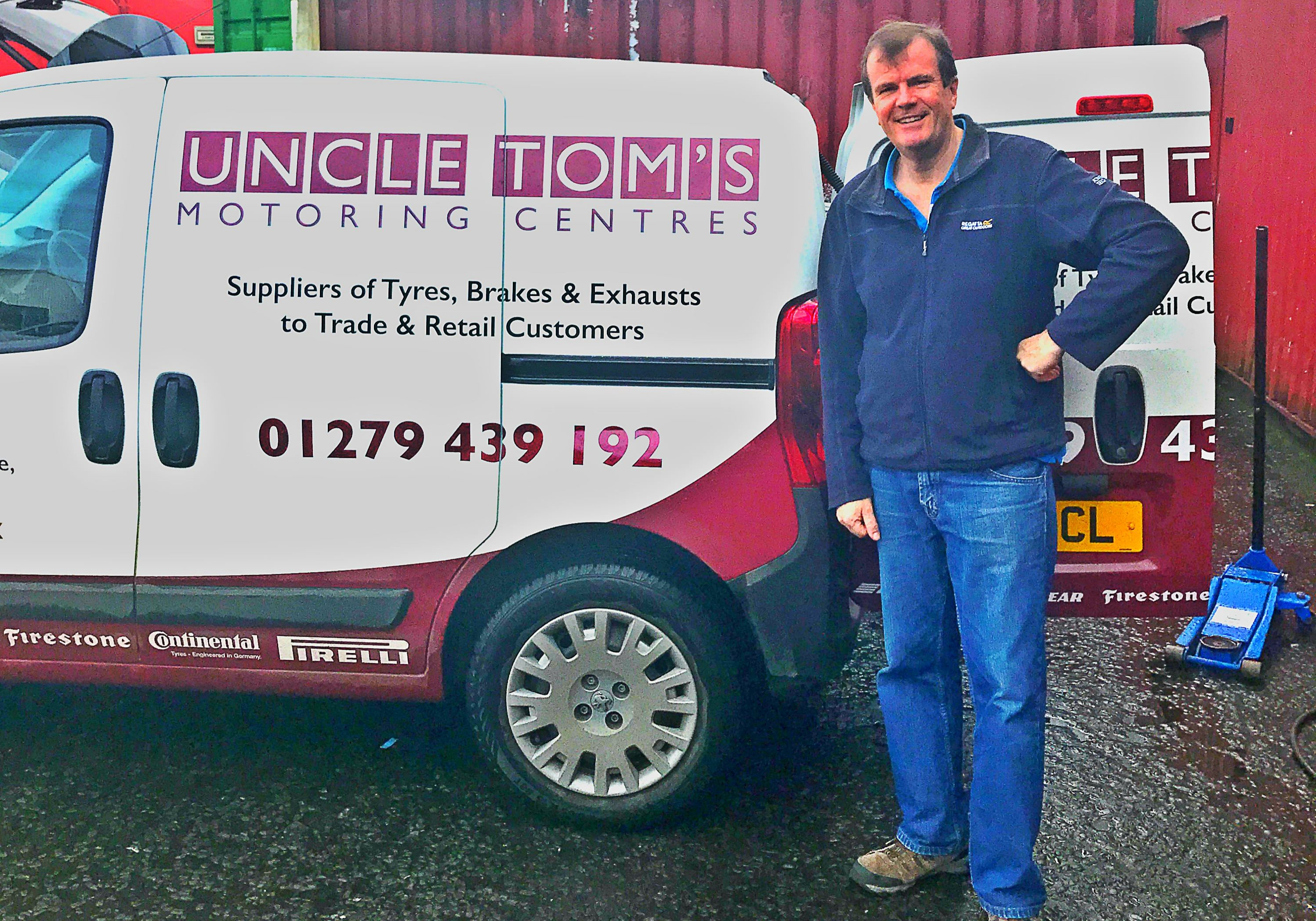 Laurence Nicholls  from Uncle Tom's stands proudly alongside his van after joining the First Stop Network